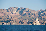 Sea of Cortez, Baja California, Mexico; the rocky, mountainous shoreline along Angel Island in late afternoon sunlight