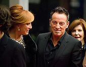Washington, DC - December 5, 2009 -- Bruce Springsteen, one of the 2009 Kennedy Center honorees, right, and his wife, Patti Scialfa Springsteen, left, arrives for the formal Artist's Dinner at the United States Department of State in Washington, D.C. on Saturday, December 5, 2009..Credit: Ron Sachs / CNP.(RESTRICTION: NO New York or New Jersey Newspapers or newspapers within a 75 mile radius of New York City)