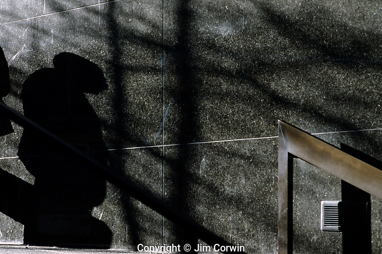 Man silhouetted against a marble wall downtown Seattle Washington State USA