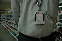 An Indian software professional wearing an identity card of Progeon company, at a shoping mall in Bangalore, Karnataka, India. Arindam Mukherjee