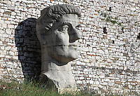 Giant head of Constantine the Great, 272-337 AD, Roman Emperor, at Berat Castle or Kalaja e Beratit, in Berat, South-Central Albania, capital of the District of Berat and the County of Berat. The castle dates mainly from the 13th century and contains Byzantine churches, Ottoman mosques and housing. It is built on a rocky hill on the left bank of the river Osum. Picture by Manuel Cohen