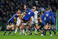 Rhys Ruddock of Leinster Rugby  is tackled by Max Lahiff of Bath Rugby. European Rugby Champions Cup match, between Leinster Rugby and Bath Rugby on January 16, 2016 at the RDS Arena in Dublin, Republic of Ireland. Photo by: Patrick Khachfe / Onside Images