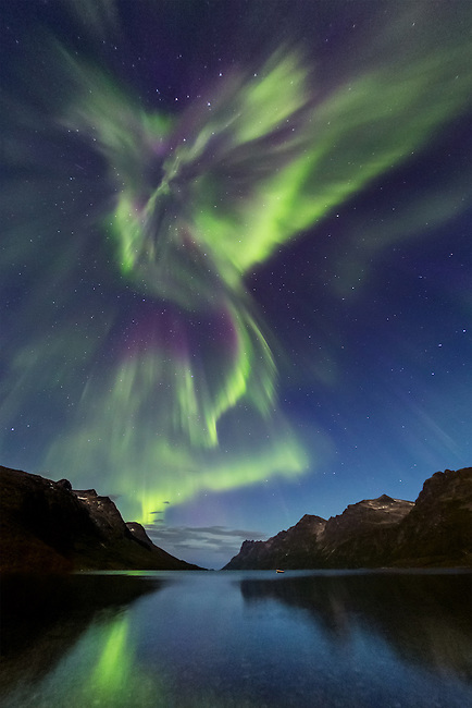 A very powerful auroa over the fjord Ersfjordbotn, close to Troms&oslash;, on sept.5th,2012. This special aurora has a shape which reminds of a dragon. The head of the dragon is made by a &quot;coronal aurora&quot;.<br /> <br /> This shot was featured on National Geographics Daily news on Sept.6th 2012:<br /> <br /> http://news.nationalgeographic.com/news/2012/09/pictures/120906-auroras-northern-lights-sun-solar-flare-science/#/03-aurora-borealis-sept_58938_600x450.jpg
