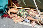 A young man lies dead, aftermath of Thai soldiers crackdown wihn the Red-shirt camp in Lumpini Park during the military operation to end the Red-shirt protests.
