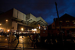 Fans making their way towards the famous Kop stand at Anfield, illuminated before Liverpool football club's Carling Cup third round tie at home to Northampton Town. The visitors from English League 2 defeated Premier League Liverpool on penalty kicks after a 2-2 draw after extra time in one of the biggest shock results in either clubs histories.