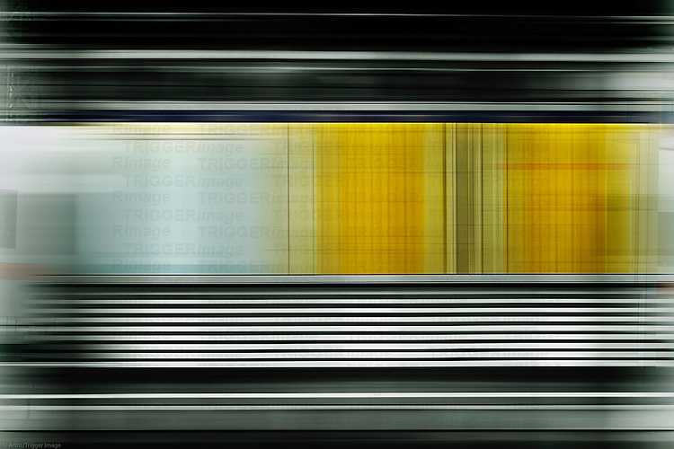 The abstract movement stripes of a train at a schedule in a train station.