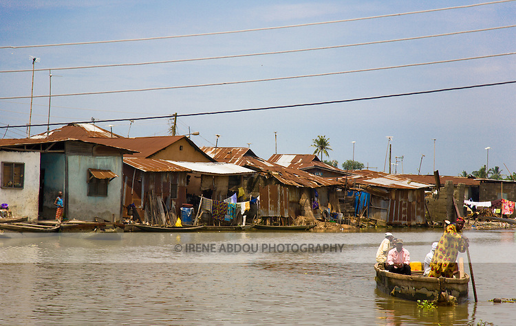 A boat ferries residents between Agboyi-Ketu island and the Lagos mainland in Nigeria.