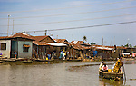 A boat ferries residents between Agboyi-Ketu island and the Lagos mainland in Nigeria.