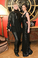 (l) Samantha Phillips, Director of Agency Model Management, poses with model at the Romas by Linda Rowe Thomas, Fall/Winter 2011 collection, during New York Fashion Week.