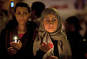 Egyptian women hold candles during a February 09, 2011 candlelight vigil for victims of the 2 week long Egyptian uprising against the Hosni Mubarak regime in Tahrir Square in downtown Cairo, Egypt. Human Rights groups claim close to 300 people have lost their lives so far during the unprecedented and widespread protests across Egypt that threaten to topple the nearly 30 year old regime of Mubarak. (Photo by Scott Nelson)