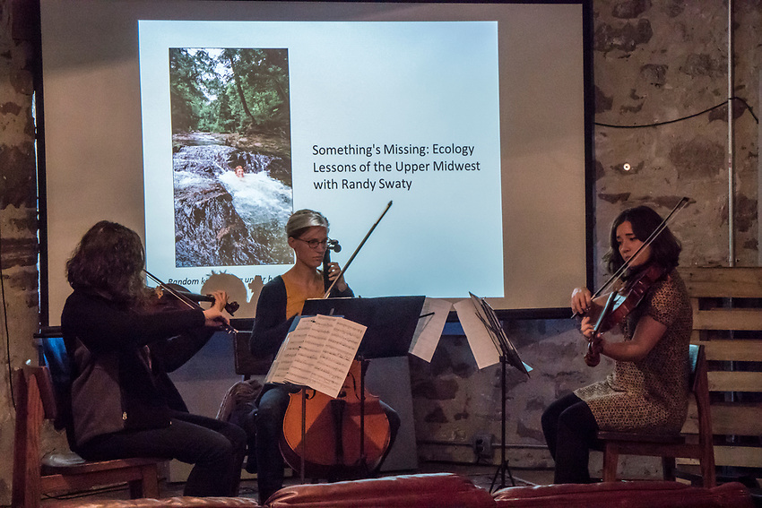 A musical trio opens a Fresh Coast Conversation forum during the Fresh Coast FIlm Festival in Marquette, Michigan.
