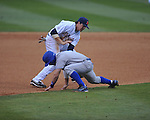 Ole Miss third baseman Andrew Mistone (25) tags out Memphis' Jacob Wilson (9) in a rundown at Oxford-University Stadium in Oxford, Miss. on Tuesday, February 28, 2012. Ole Miss won 7-2.