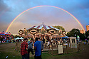 Rainbow  after a summer shower over the Field Day Festival @ Victoria park. (East) London. UK