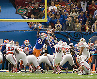 Earl Okine of Florida and Sharrif Floyd of Florida try to block a field goal during 79th Sugar Bowl game against Louisville at Mercedes-Benz Superdome in New Orleans, Louisiana on January 2nd, 2013.   Louisville Cardinals defeated Florida Gators, 33-23.