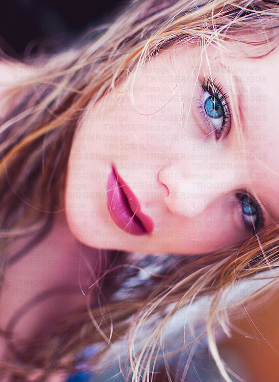 Close up of young woman with wet blonde hair and blue eyes