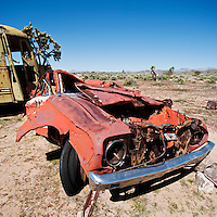 Crushed abandoned car in Mojave desert, California, USA