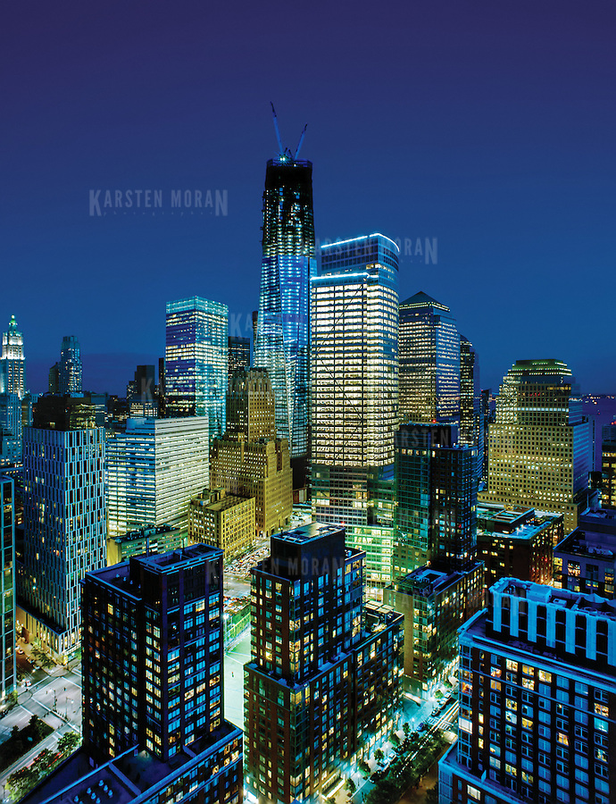 May 10, 2012 - New York, NY : 1 World Trade Center, alternatively called the World Trade Center, or Freedom Tower, rises above the skyscrapers of lower Manhattan, New York City on May 10. Scheduled to be completed in early 2014, the building was designed to become the tallest structure in the United States.  ***This image is a panorama comprised of multiple individual frames taken in succession using a shift lens, then stitched together using digital imaging software. Parts of the sky have been blended to reduce posterization.***