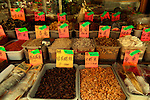 Dried Chinese herbs, mushrooms, and spices in front of a grocery shop in Chinatown, New York City