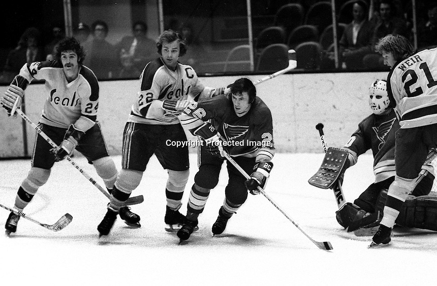 California Golden Seals Pete LaFramboise and Joey Johnston , Don Awrey of St. Louis, Stan Weir. <br />