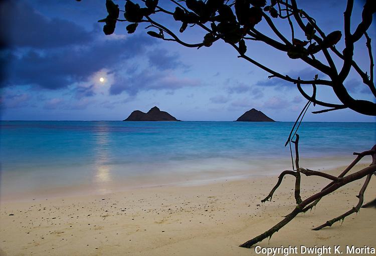 Full moon rising over Mokulua Islands as seen from Lanikai Beach