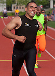 West Point, New York -  Army's Michael Kacer smiles after winning his heat of the 100-meters at the 2014 Army Warrior Trials at the United States Military Academy Preparatory School on Tuesday, June 17, 2014.<br />