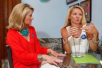 NWA Democrat-Gazette/DAVID GOTTSCHALK - 5/28/15 - Katie Tennant (left) and Sarah Sparks Diebold describe the Fayetteville Future Fund/Fayetteville Area Community Foundation Thursday May 28, 2015 in Fayetteville.