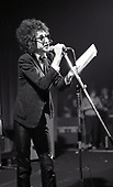 John Cooper Clarke - punk poet - performing live at the Lyceum Theatre in London UK - 10 Mar 1978.  Photo credit: George Bodnar Archive/IconicPix