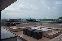 The living area of a very slick and contemporary condominium in Chicago's Wicker Park neighborhood of international professional soccer star Mr. Bakary Soumare, who played the defender position for the Chicago Fire during the 2008 and 2009 seasons.