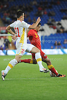 Cardiff City Stadium, Friday 11th Oct 2013. Neil Taylor of Wales battles with Mirko Ivanovski of Macedonia during the Wales v Macedonia FIFA World Cup 2014 Qualifier match at Cardiff City Stadium, Cardiff, Friday 11th Oct 2014. All images are the copyright of Jeff Thomas Photography-07837 386244-www.jaypics.photoshelter.com