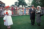 Royal Ascot, them and us in the Members Enclosure. Berkshire England.  The English Season published by Pavilon Books 1987. Page 88.