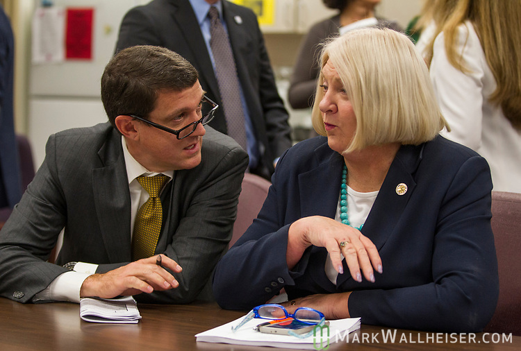 David Daniel,left,  a lobbyist with Smith, Bryan & Myers, talks with Sen. Linda Stewart, D-Orlando, after the Democratic Caucus meeting in the Senate office building at the Florida Capitol in Tallahassee, Florida.