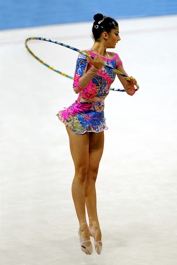 Eleni Andriola of Greece turns with hoop during All-Around final at Athens Olympic Games on August 29, 2004 at Athens, Greece. (Photo by Tom Theobald)