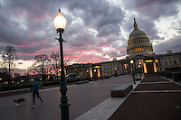 A woman jogs with her dog near the U.S. Capitol following the Inauguration of President Barack Obama on Monday, January 21, 2013 in Washington, DC.