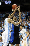17 February 2016: Duke's Derryck Thornton (12) shoots over North Carolina's Marcus Paige (5). The University of North Carolina Tar Heels hosted the Duke University Blue Devils at the Dean E. Smith Center in Chapel Hill, North Carolina in a 2015-16 NCAA Division I Men's Basketball game. Duke won the game 74-73.