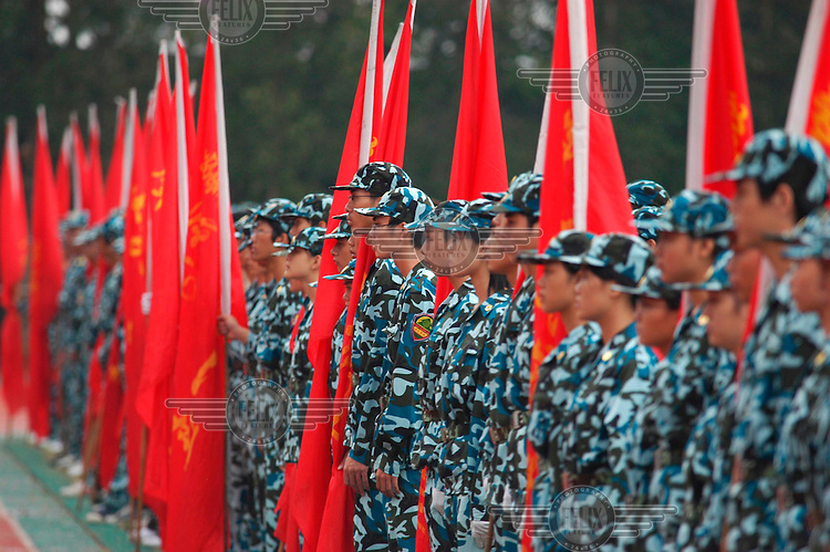 The first two weeks of a Chinese University student's life is spent in military uniform learning marching and basic battlecraft. This culminates in a passing out parade in front of military generals and university academic staff. Zhaoqing University.