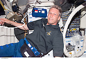 In Earth Orbit - July 6, 2006 -- European Space Agency (ESA) astronaut Thomas Reiter of Germany floats on the middeck of the Space Shuttle Discovery. This was among the first group of digital still images showing the crewmembers onboard during their first full day in space..Credit: NASA via CNP