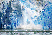 Pieces of the ice face from the North Sawyer Glacier crash into the waters of Tracy Arm. Tracy Arm and Fords Terror are fjords which cut into the Coast Mountains of Southeast Alaska. Alaska, Tracy Arm-Fords Terror Wilderness Area.