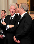 Former United States President Bill Clinton shares some thoughts with an unidentified person as the recipients of the 2011 Kennedy Center Honors pose for a photo following a dinner hosted by U.S. Secretary of State Hillary Rodham Clinton at the U.S. Department of State in Washington, D.C. on Saturday, December 3, 2011. The 2011 honorees are actress Meryl Streep, singer Neil Diamond, actress Barbara Cook, musician Yo-Yo Ma, and musician Sonny Rollins..Credit: Ron Sachs / CNP