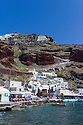 Santorini, Greece. 06.05.2014. The old fishing village of Ammoudi nestles at the foot of the cliffs, below the town of Oia at the northern tip of the island. Whilst still small, the front now has a few restaurants geared to the seasonal, tourist, influx. Photograph © Jane Hobson.