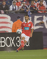 SL Benfica defender Luis Filipe (22) passes the ball. SL Benfica  defeated New England Revolution, 4-0, at Gillette Stadium on May 19, 2010.