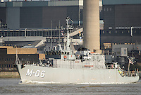 The NATO minehunter LVNS Talivaldis (M-06) steams upriver on the River Thames.