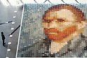 May 13, 2010 - Tokyo, Japan - A visitor looks at a reproduction of a Vincent van Gogh self-portrait made of 2,070 polo shirts in 24 different colors, at Marunouchi Building, Tokyo, Japan, on May 13, 2010.The mosaic was created by Tokyo-based apparel maker Onward Kashiyama Co. as part of its campaign to incorporate colors of paintings into clothing designs.