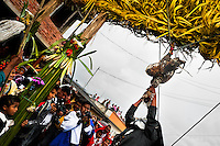"""A native from the Kamentsá tribe tears off a rooster's head during a ritual of the Carnival of Forgiveness, a traditional indigenous celebration in Sibundoy, Colombia, 12 February 2013. Clestrinye (""""Carnaval del Perdón"""") is a ritual ceremony kept for centuries in the Valley of Sibundoy in Putumayo (the Amazonian department of Colombia), a home to two closely allied indigenous groups, the Inga and Kamentsá. Although the festival has indigenous origins, the Catholic religion elements have been introduced and merged with the shamanistic tradition. Celebrating annually the collaboration, peace and unity between tribes, they believe that anyone who offended anyone may ask for forgiveness this day and all of them should grant pardons."""