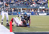 Seattle Seahawks wide receiver Bobby Engram stretches for a first down during the fourth quarter while being brought down by New York Giants cornerback #23 Corey Webster. Engram was one yard short on the play and Seattle had to go for it on fourth and 1 at the 2 yard line at Quest Field in Seattle, WA.