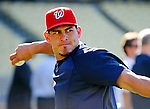 22 July 2011: Washington Nationals catcher Wilson Ramos warms up prior to starting against the Los Angeles Dodgers at Dodger Stadium in Los Angeles, California. The Nationals defeated the Dodgers 7-2 in their first meeting of the 2011 season. Mandatory Credit: Ed Wolfstein Photo