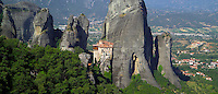 Kalambaka, Kastraki, Meteora, Greece, June 2006. Roussanou monastery with the village of Kastraki in the background. The Monastaries of Meteora can be found high on the steepest rocks, Photo by Frits Meyst/Adventure4ever.com