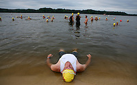 Photo by Gary Cosby Jr.    Max Norman lies in the edge of the water as he prepares himself to compete in the Wet Dog Triathlon in Point Mallard Park Saturday morning.