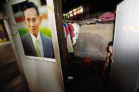 "Thailand. Bangkok. A young man, who lives as a squatter  in Tha Tian, with his clothes hanged . The man works as a coolie in Tha Tian. A picture of King Bhumibol is taped on the wall. Bhumibol Adulyadej (born 5 December 1927), is the current King and Head of the State of Thailand. Publicly acclaimed ""the Great"" he is also known as Rama IX. Having reigned since 9 June 1946, he is the world's longest-serving current head of state and the longest-serving monarch in Thai history. Tha Tian is a community located in the downtown area and in the center of the urban historic district, called Koh Rattanakosin. 28.03.09 © 2009 Didier Ruef"