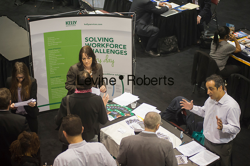 Job seekers attend the Putting America Back to Work Job Fair at the Jacob Javits Convention Center in New York on Tuesday, May 7, 2013.  ( © Frances M. Roberts)