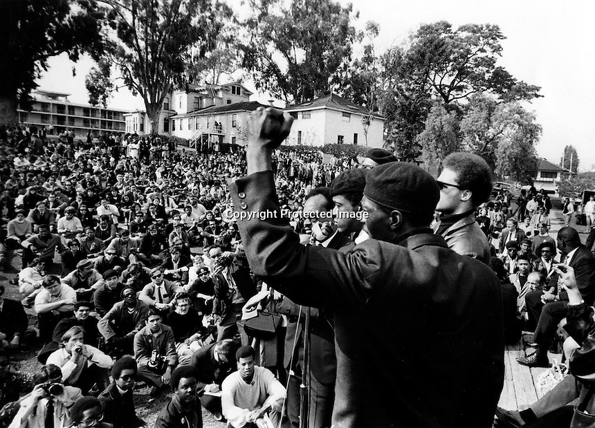 Black Panther rally at Lakeside Park in Oakland, Ca.Panthers Bobby Seale and William Lee Brent on the stage along with other Panther members. (1968 photo by Ron Riesterer)(copyright@1968)